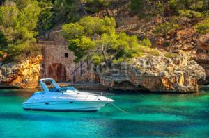 Beautiful white yacht in harbor of Cala Figuera, Mallorca, Spain - GlobePhotos