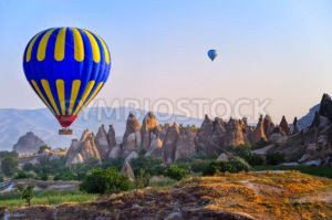 Cappadocia hot air balloon flying over bizarre rock landscape in Turkey - GlobePhotos
