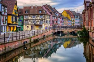 Colorful half-timbered facades in medieval town Colmar, Alsace, France - GlobePhotos