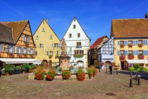 Colorful half-timbered houses in Eguisheim, Alsace, France - GlobePhotos