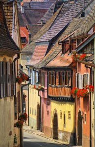 Colorful houses in a street in alcacian village by Colmar, Alsace, France - GlobePhotos