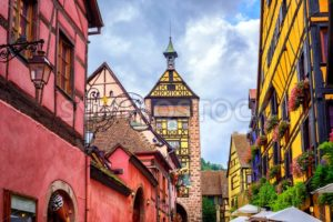 Colorful houses on a central street in Riquewihr, village on wine route in Alsace, France - GlobePhotos
