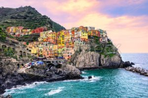 Colorful houses on a rock in Manarola, Cinque Terre, Italy - GlobePhotos - royalty free stock images