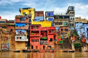 Colorful houses on river Ganges, Varanasi, India - GlobePhotos