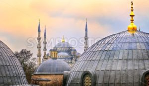 Domes of Blue Mosque in Istanbul on sunset - GlobePhotos