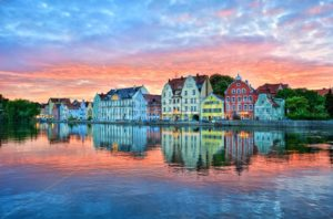 Dramatic sunset over old town of Landshut on Isar river near Munich, Germany - GlobePhotos