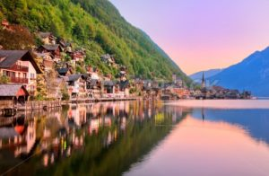 Hallstatt town reflecting in the lake on sunset, Salzkammergut, Austria - GlobePhotos