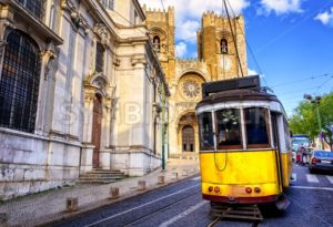 Historical yellow tram in front of the Lisbon cathedral, Lisbon, Portugal - GlobePhotos