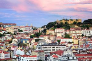 Lisbon, Portugal, view to the Alfama quarter and St. Jorge Castle at sunset - GlobePhotos