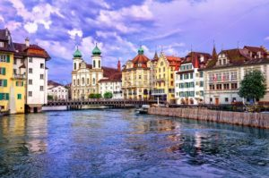Lucerne, Switzerland, on sunset. View over Reuss river to Jesuit Church - GlobePhotos
