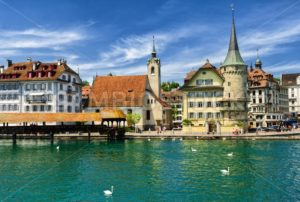Lucerne, Switzerland, view over Reuss river to the old town, the Chapel and wooden Chapel bridge - GlobePhotos