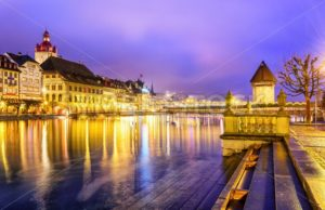 Lucerne, Switzerland. View over Reuss river to the old town and Water tower in the evening. - GlobePhotos