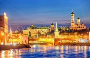 Moscow Kremlin glowing in the evening light over Moskva River, Russia - GlobePhotos