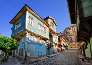 Old traditional ottoman house street with the Karahisar castle in background, Afyon, Turkey - GlobePhotos