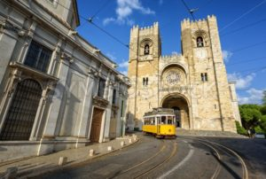 Old tram in front of cathedral in Lisbon, Portugal - GlobePhotos