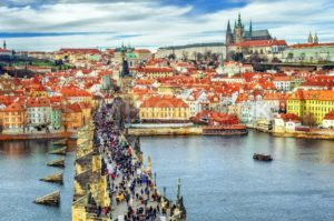 Panorama of Prague with the Castle, Charles Bridge, Vltava river and red roofs of the old town, Czech Republic - GlobePhotos