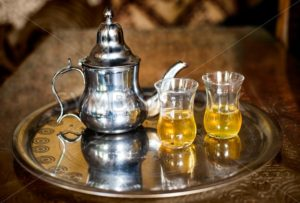 Set of arabic nana mint tea with metal tea pot and glasses - GlobePhotos