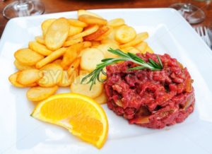 Steak tartare served with french fries potato chips - GlobePhotos