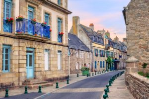 Stone houses on a street in Roscoff, Brittany, France - GlobePhotos