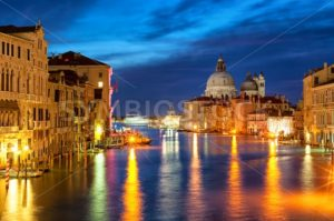 The Grand Canal and Santa Maria della Salute basilica, Venice, Italy, at night - GlobePhotos