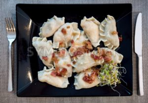 Traditional polish Pierogi stuffed dumplings - GlobePhotos