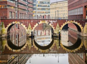 Bridge reflecting in canal in Hamburg city, Germany - GlobePhotos - royalty free stock images