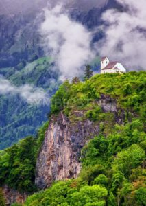 Church on a rock in swiss Alps mountains - GlobePhotos - royalty free stock images