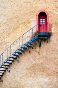 Decorated stairs leading to a door in terracotta wall - GlobePhotos - royalty free stock images