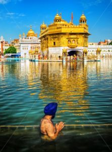 Sikh prayer in lake of Golden Temple, Amritsar, India - GlobePhotos - royalty free stock images