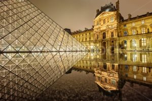 Louvre museum and glass Pyramid at night, Paris, France - GlobePhotos - royalty free stock images