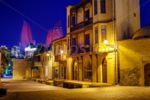 Baku Old Town and Flame Towers at night, Azerbaijan - GlobePhotos - royalty free stock images