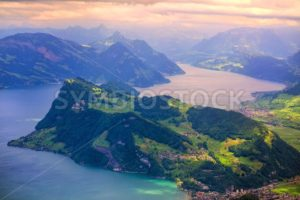 Swiss Alps mountains and Lake Lucerne on dramatic sunset - GlobePhotos - royalty free stock images