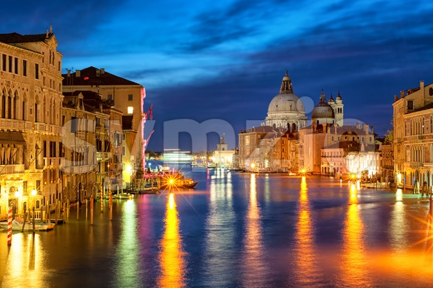 The Grand Canal and Santa Maria della Salute basilica, Venice, Italy, at night Stock Photo