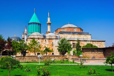 Tomb of Mevlana, the founder of Mevlevi sufi dervish order, with prominent green tower in Konya, Turkey Stock Photo