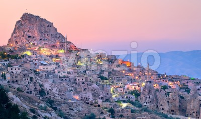 Uchisar cave city in Cappadocia, Turkey on sunset Stock Photo
