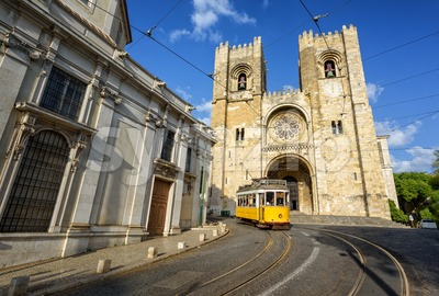 Old tram in front of cathedral in Lisbon, Portugal Stock Photo