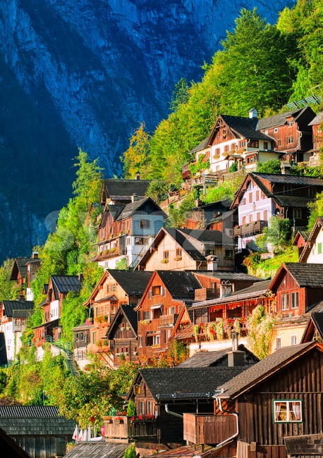 Traditional wooden houses on the mountain slope in Hallstatt, Austria Stock Photo
