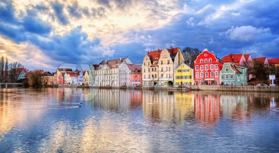 Colorful gothic houses reflecting in Isar river on sunset, Landshut, Munich, Germany Stock Photo