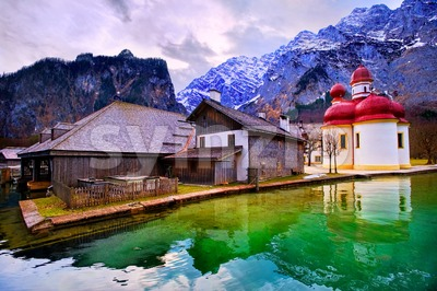 St Bartholomew church on mountain lake Konigsee in german Alps by Munich, Germany Stock Photo