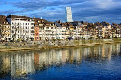 Houses along the Rhine river with Roche Tower in background, Basel, Switzerland Stock Photo