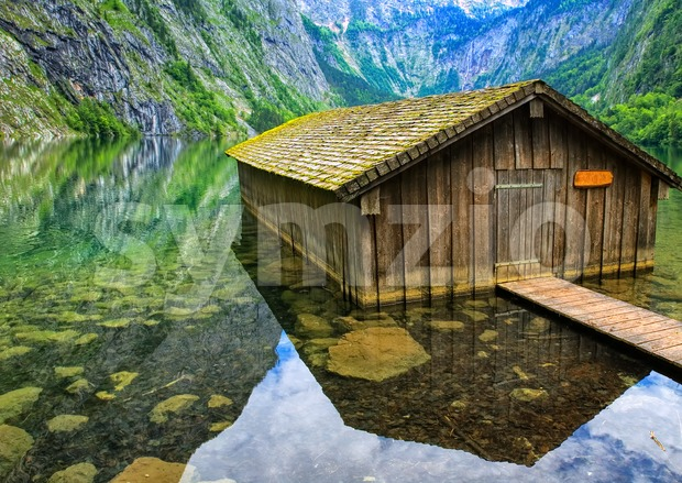 Fisherman's house on alpine lake Konigsee in the Alps mountains, Germany