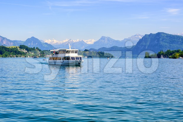 Cruise ship in front of Alps mountains peaks on Lake Lucerne, Switzerland Stock Photo