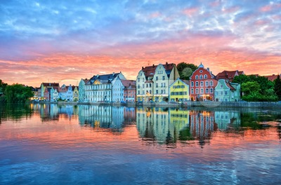 Dramatic sunset over old town of Landshut on Isar river near Munich, Germany Stock Photo