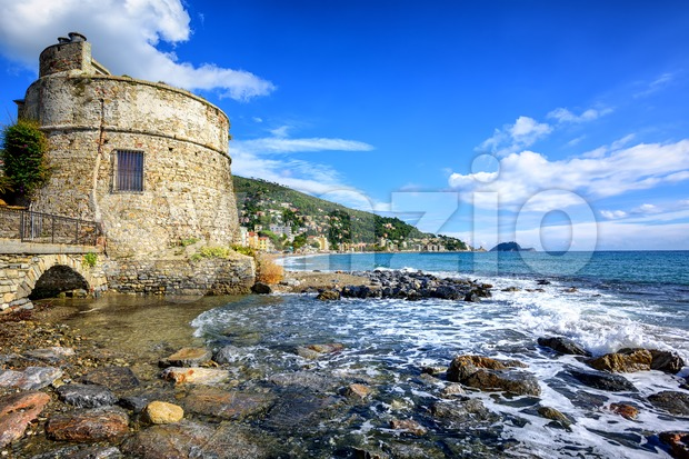 Historical Saracen tower in Alassio, resort town on Riviera, Italy Stock Photo