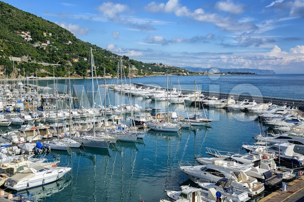 White yachts docked in port of Alassio on Riviera, Italy Stock Photo