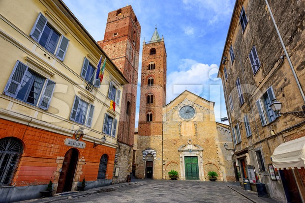 Romanesque church with high bell towers in the center of medieval town Albenga, Italy