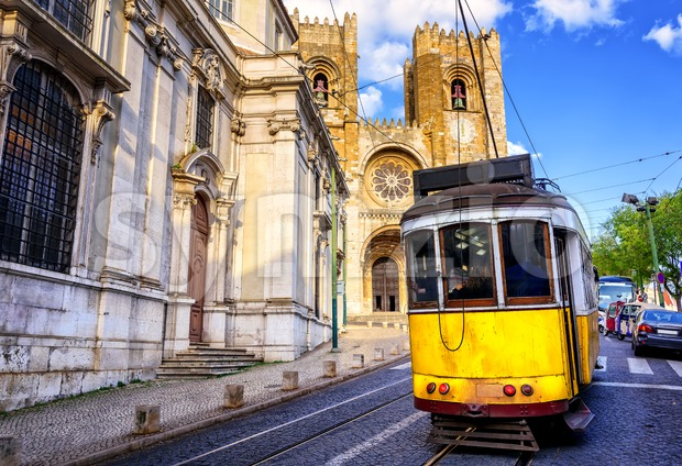 Historical yellow tram in front of the Lisbon cathedral, Lisbon, Portugal Stock Photo