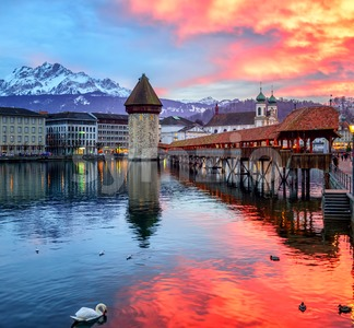 Dramatic sunset over the old town of Lucerne, Switzerland Stock Photo