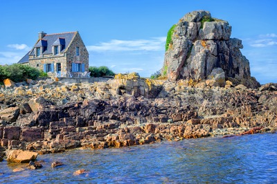 Traditional breton stone house and the rock, Brittany, France Stock Photo