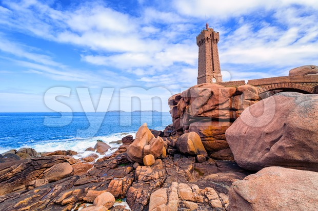 Lighthouse of Ploumanach Mean Ruz in Perros-Guirec on Pink Granite Coast, Brittany, France